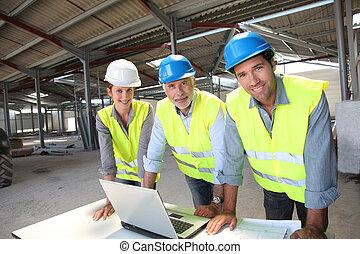 portrait, site construction, équipe