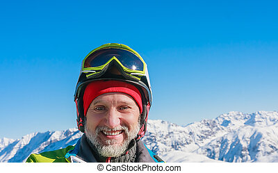 Portrait skier mountains in the background