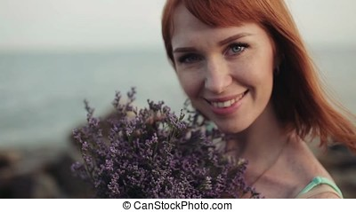 Portrait. Slow motion. Beautiful sexy girl with a beautiful smile on the sea background