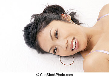 Portrait smiling Pacific Islander Woman reclining