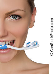 Portrait smiling woman with toothbrush in teeth