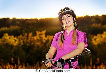 portrait, soir, cyclisme femme