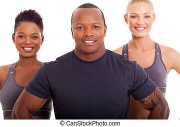 sporty african man and two women on white background