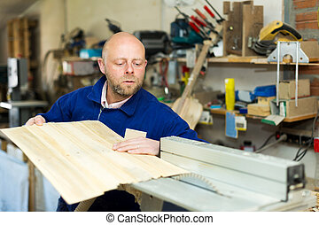 craftsman working with unfinished guitar - Portrait...