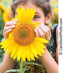 Portrait teen girl and sunflower