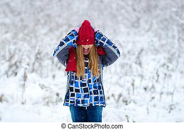 Portrait teen girl in winter forest