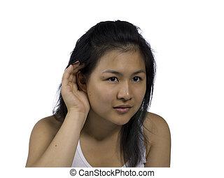 teenage girl making listening gesture