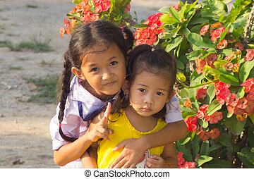 Portrait Thai girls with Euphorbia milli flower, children