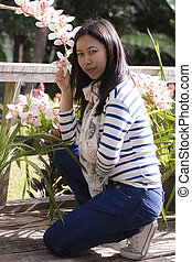 Portrait Thai woman with cymbidium flower