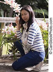 Portrait Thai woman with cymbidium flower