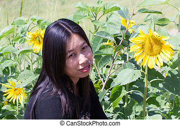 Portrait Thai woman with sunflowers