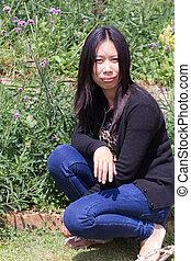 Portrait Thai woman with Verbena garden