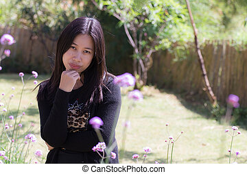 Portrait Thai woman with Verbena garden