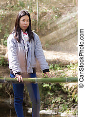 Portrait thai woman with wood bridge
