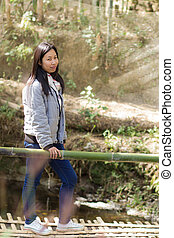 Portrait thai woman with wood bridge