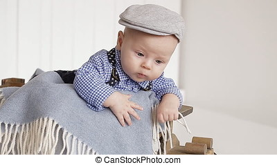 Portrait Three-Month Baby in The Gray Cap