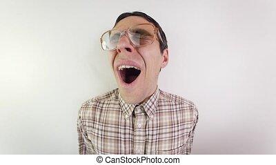 Portrait tired yawning nerd in glasses - Funny nerd yawning ...