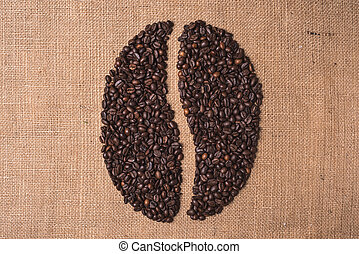 portrait toasted coffee shape beans top view on juta textile