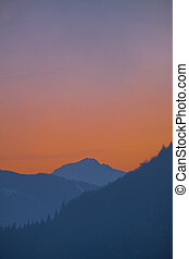 Portrait view over valley Ennstal to sunset over mountain Gumpeneck