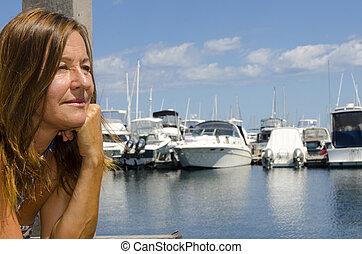 Portrait woman at marina