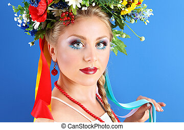 portrait woman makeup with flowers on blue background, spring concept