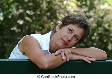 Portrait - Woman sitting in a park.