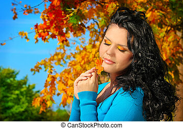 Portrait woman with beauty make up in autumn leaves outdoors