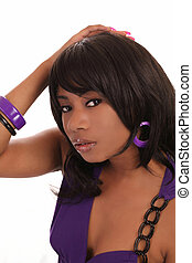Portrait young African American woman purple dress