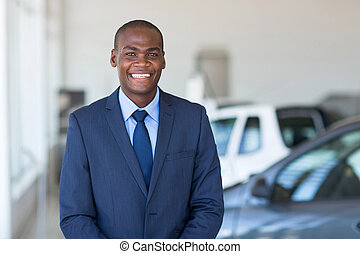young african businessman in car showroom