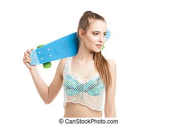 Portrait young beautiful girl posing with Longboard -...