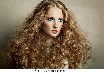 Portrait young beautiful woman with curly hair