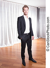 Portrait young business man in suit
