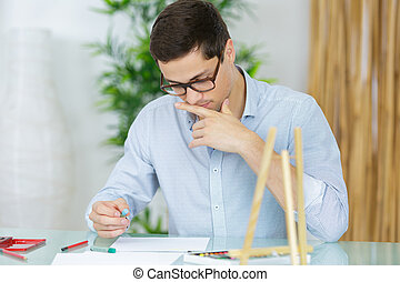 portrait young businessman in his office