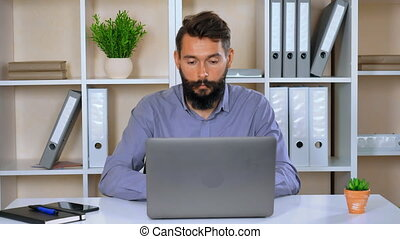 portrait young businessman using computer indoors