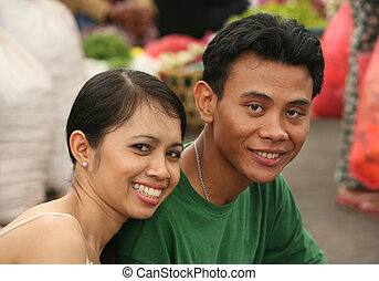 Portrait young men - Indonesian the man and the woman. Bali....