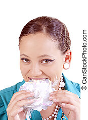 Portrait young mixed woman biting cloth flower