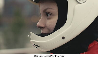 Portrait young smiling woman in a protective helmet slow motion