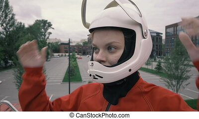 Portrait young woman wearing a protective helmet. Girl in protective helmet