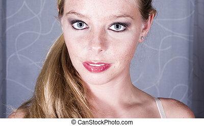 Portraits of a mature blond - Studio portrait of a...
