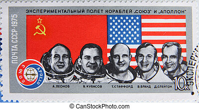 portraits of astronauts on stamp
