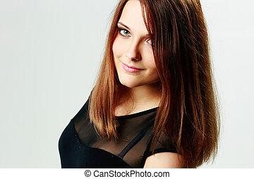 portret, od, niejaki, młody, uśmiechnięta kobieta, na, szare tło