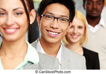 portret, od, niejaki, uśmiechanie się, grupa, handlowy zaludniają