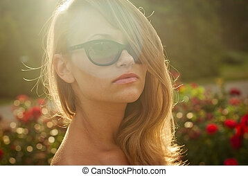 portrait of young sexy model in contr sunlight outdoor