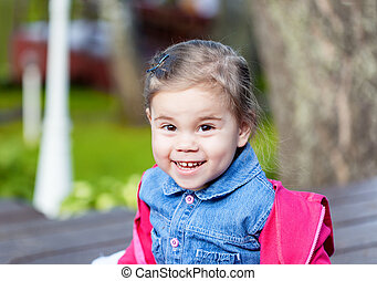 Portriat of cute little smilling girl