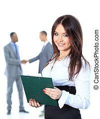 Portrrait of a smiling young business woman with people discussing in background