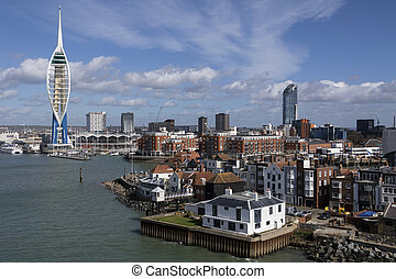 The harbor area and Spinnaker Tower in the city of Portsmouth on the south coast of England in the United Kingdom.