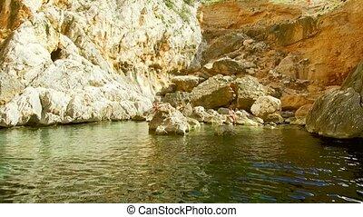 The narrow steep inlet of Portu Cuau cut into the limestone rock of Capo Monte Santo, Gulf of Orosei, Gennargentu National Park Ogliastra, east coast of Sardinia - Italy. 20th of May 2019