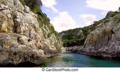 The narrow steep inlet of Portu Pedrosu cut into the limestone rock of Capo Monte Santo, Gulf of Orosei, Gennargentu National Park Ogliastra, east coast of Sardinia - Italy. 20th of May 2019