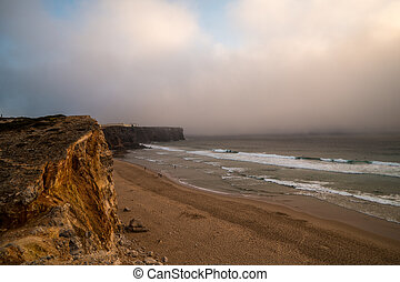 Portugal - Fort and beach - A fort in the distance and a...