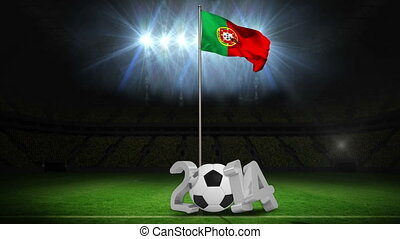 Portugal national flag waving on pole with 2014 message on football pitch